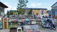 La résidence sociale a été construite sur un terrain jouxtant les activités commerciales de la communauté Emmaüs.