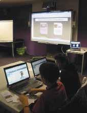 En plus de l'ENT, la classe de Christophe Caron utilise le tableau blanc numérique et des ordinateurs portables.