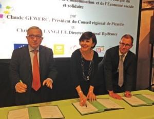 (de g. à d.) Claude Gewerc, la secrétaire d'État Carole Delga et Christophe Langlet, directeur BPI France Picardie lors de la signature du Fiso.